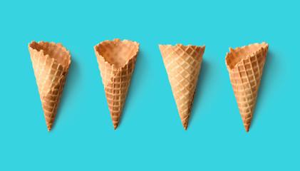 Collection of empty ice cream cones on retro color background