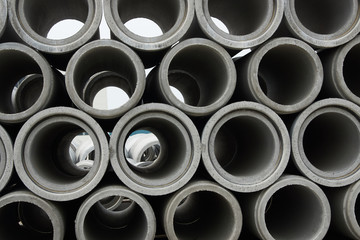 Stacked concrete pipes at concrete factory warehouse
