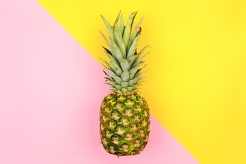 Pineapple on a modern pastel pink and yellow angular background. Minimal summer concept. Wall mural