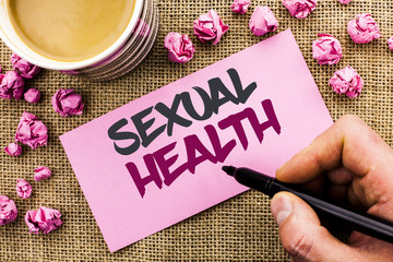 Conceptual hand writing showing Sexual Health. Business photo text STD prevention Use Protection Healthy Habits Sex Care written by Man Holding Marker on Paper on the jute background Cup