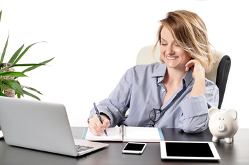 Business woman using laptop computer sitting at desk