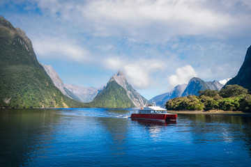 A local boat at Freshwater Basin at Milford Sound in the morning. Milford Sound is a fjord and the most beautiful natural feature of New Zealand's Southern Island.