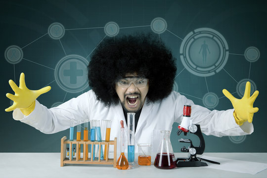 Afro scientist looks stressed with failed experiment