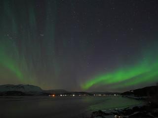 Aurora spreading over Norway's fjord