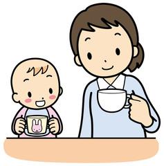 カップで飲む赤ちゃん