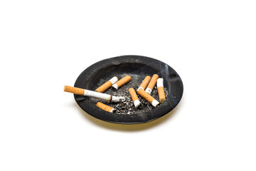 Ashtray with smoking cigarette and cigarette butts on white background