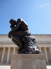 Side profile of the masterpiece the Thinker by Rodin