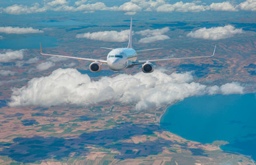 Foto op Plexiglas Zalm White passenger airplane in the clouds. travel by air transport