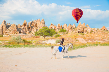 Tourists enjoy ride horses in Cappadocia