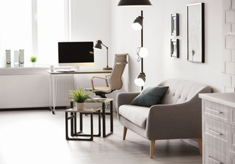Room interior with modern lamps and comfortable sofa