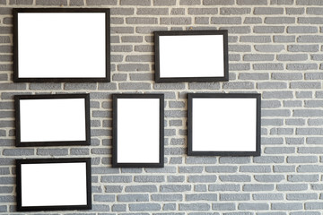 Black natural wooden frame on bricks wall. Mock up blank poster picture frame on brick wall.
