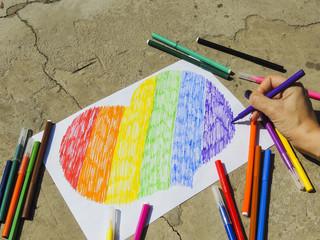 Photo of the rainbow heart on the asphalt. Symbols of LGBT people.
