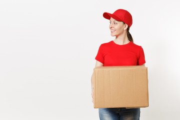 Delivery smiling woman in red uniform isolated on white background. Female in cap, t-shirt, jeans working as courier or dealer holding cardboard box. Receiving package. Copy space for advertisement.