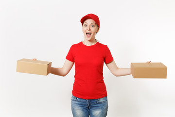 Delivery smiling woman in red uniform isolated on white background. Female in cap, t-shirt, jeans working as courier or dealer holding cardboard boxes. Receiving package. Copy space for advertisement.