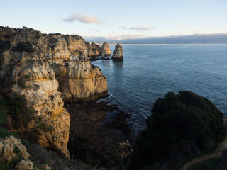 Algarve Sunrise over cliffs and Beach with Ocean View Panorama Outdoor Scene in Ponta da Piedade, Lagos, Portugal at Dusk