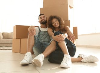 concept of moving to a new apartment. Happy couple
