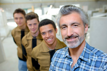 professor posing with vocational students