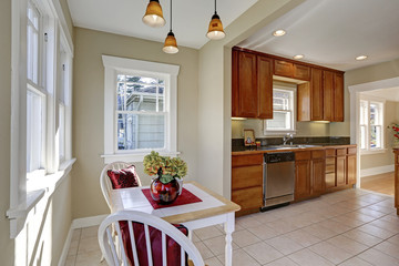 Sun filled breakfast nook opens to the kitchen