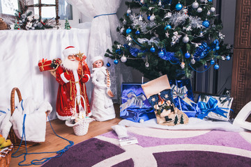 New Year's interior of room with toys, gifts, Christmas sock, Santa Claus and Snow Maiden near the Christmas tree