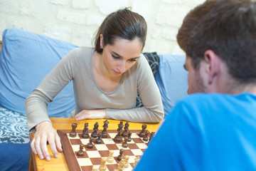 focused happy couple playing chess