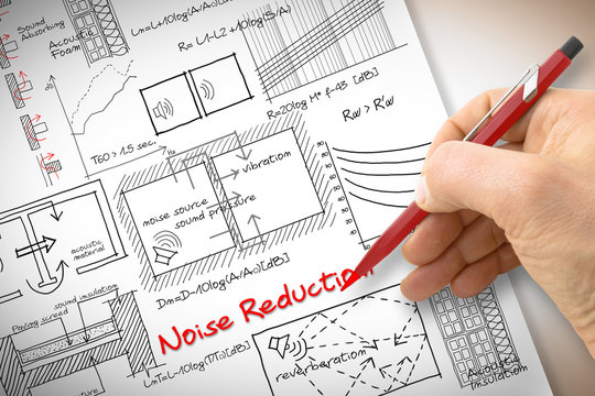 Engineer writing formulas about noise reduction in buildings - concept image
