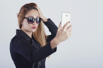 Beautiful Young woman taking a selfie