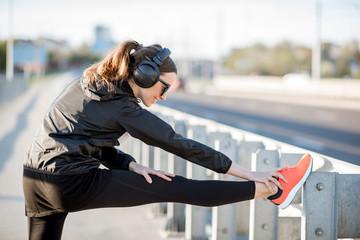 Woman exercising outdoors on the bridge