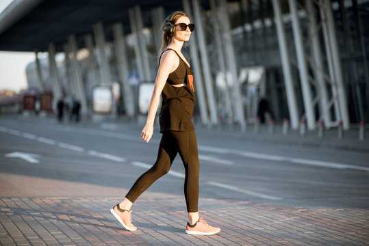 Sports woman walking during the morning exercise