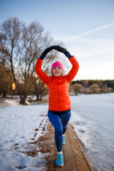Portrait of young athlete girl on morning exercise in winter
