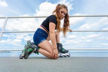 Woman putting roller skates on
