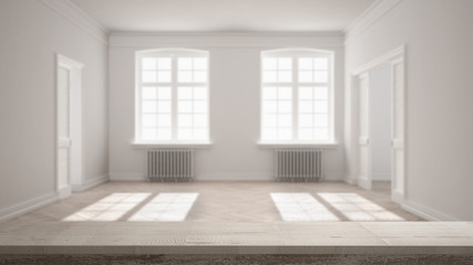 Wooden vintage table top or shelf closeup, zen mood, over blurred empty room with parquet floor, big windows, doors and radiators, white architecture interior design