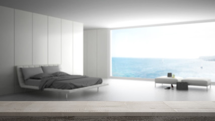 Wooden vintage table top or shelf closeup, zen mood, over blurred minimalist bedroom with big window on sea panorama, white architecture interior design
