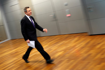 European Central Bank (ECB) President Mario Draghi arrives for a news conference following the governing council's interest rate decision at the ECB headquarters in Frankfurt