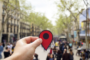 man with a red marker in Las Ramblas, Barcelona.