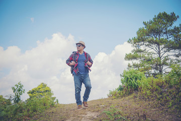 Young professional traveler man with camera shooting outdoor, fantastic mountain landscape