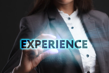The concept of business, technology, the Internet and the network. A young entrepreneur working on a virtual screen of the future and sees the inscription: Experience