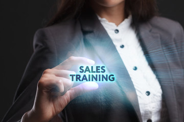 The concept of business, technology, the Internet and the network. A young entrepreneur working on a virtual screen of the future and sees the inscription: Sales training