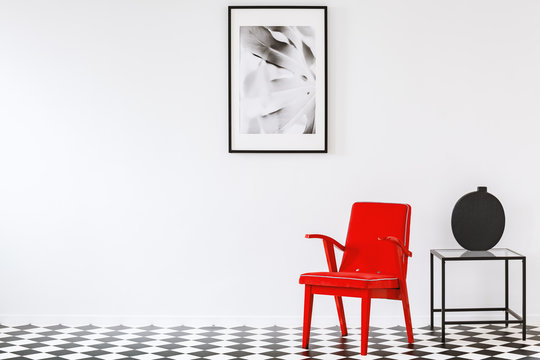 Red armchair in white interior