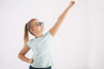 Young girl in superhero pose