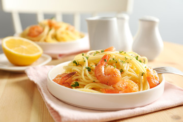 Delicious pasta with shrimps on plate
