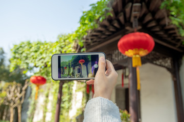 use smart phone to take pictures for a Chinese traditional house