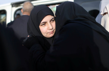 The wife of Palestinian engineering lecturer Fadi al-Batsh, who was shot dead in Malaysia, is hugged upon her husbandÕs body arrival in the southern Gaza Strip