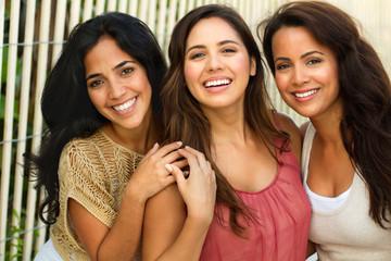 Beautiful Hispanic women smiling at the beach.