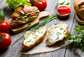 Croissant sandwich with fresh vegetables and cheese