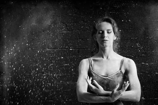 portrait of girl ballet dancer in the dust cloud