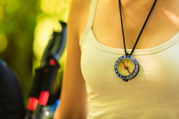 Woman with compass pendant.