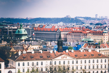 Panoramic view of Prague roofs and domes. Czech Republic. Europe. Filtered image:cross processed retro effect.