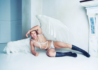 male model with big white angel wings