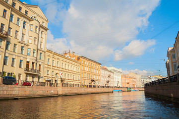 Historic buildings and embankment of Moika river in sunny day in St Petersburg, Russia
