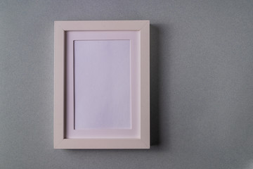 Mockup. Abstract minimalism gray paper background with empty picture frame.